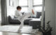7 years old boy dressed in kimono, training taekwondo at home.
